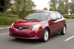 2010 Nissan Sentra SL Sedan in Red Brick Pearl - Driving Front Left View