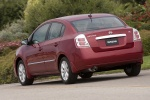 2010 Nissan Sentra SL Sedan in Red Brick Pearl - Driving Rear Left View