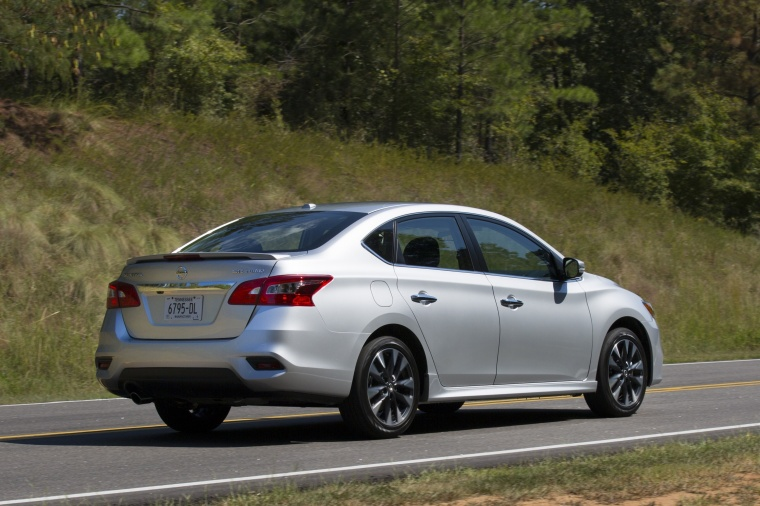 Driving 2017 Nissan Sentra SR Turbo in Brilliant Silver from a rear right three-quarter view