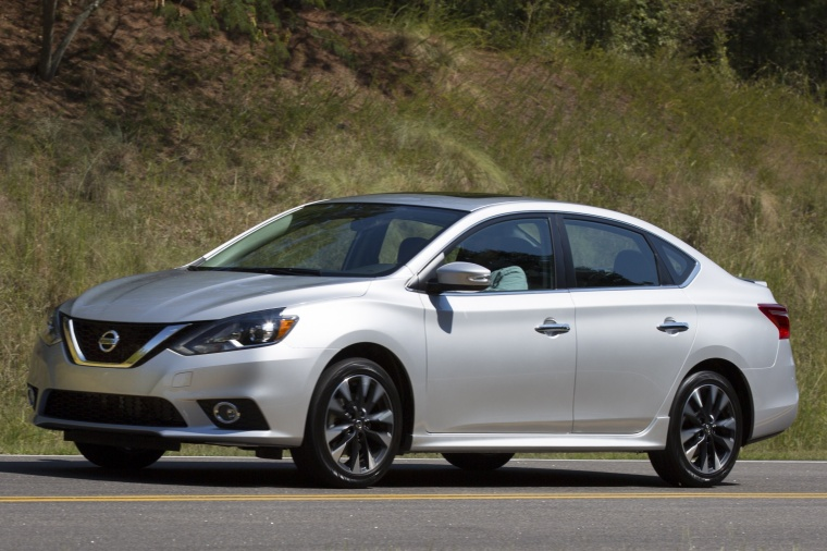 Driving 2017 Nissan Sentra SR Turbo in Brilliant Silver from a left side view