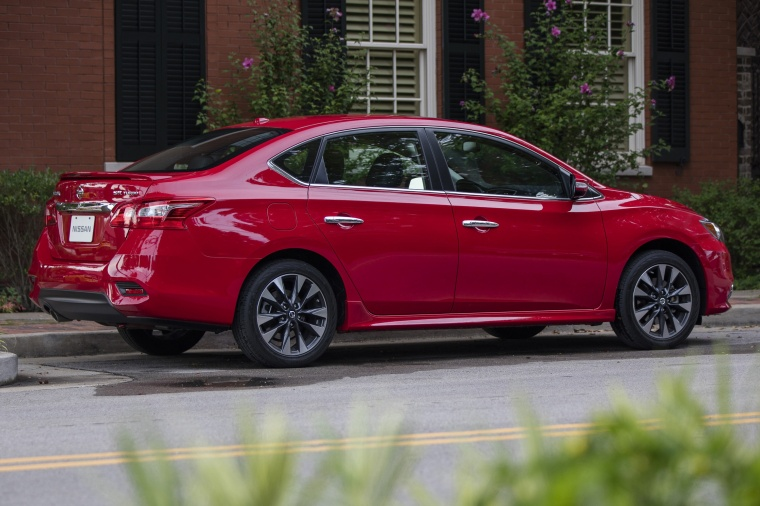 2017 Nissan Sentra SR Turbo in Red Alert from a rear right three-quarter view