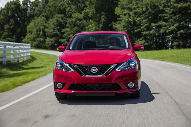Driving 2017 Nissan Sentra SR Turbo in Red Alert from a frontal view
