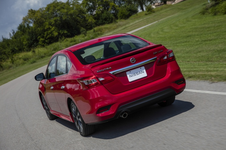 Driving 2017 Nissan Sentra SR Turbo in Red Alert from a rear left view