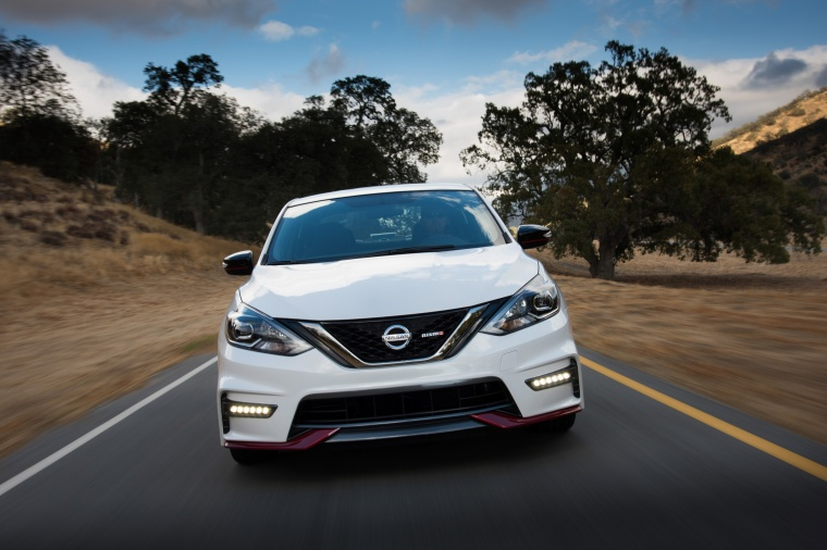 Driving 2017 Nissan Sentra NISMO in Fresh Powder from a frontal view