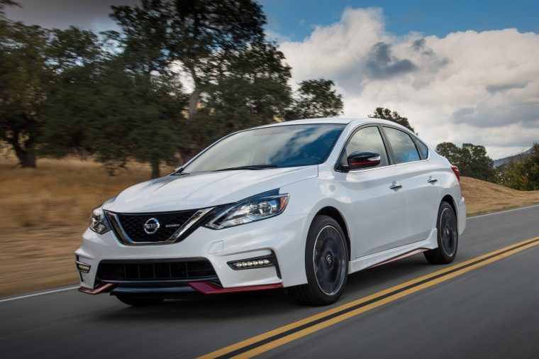 Driving 2017 Nissan Sentra NISMO in Aspen White from a front left view