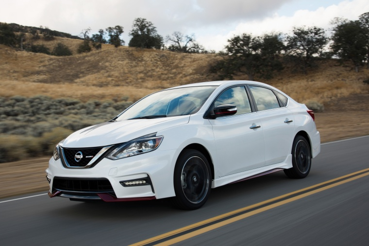 Driving 2017 Nissan Sentra NISMO in Fresh Powder from a front left three-quarter view