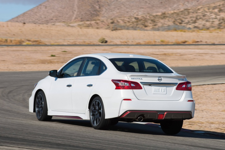 Driving 2017 Nissan Sentra NISMO in Fresh Powder from a rear left view