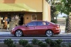 2017 Nissan Sentra SL in Cayenne Red Pearl Metallic from a side view