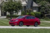 Driving 2017 Nissan Sentra SR Turbo in Red Alert from a front left three-quarter view