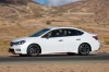 Driving 2017 Nissan Sentra NISMO in Fresh Powder from a left side view