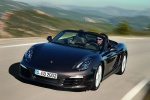 2014 Porsche Boxster in Anthracite Brown Metallic - Driving Front Left View