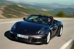 2015 Porsche Boxster in Anthracite Brown Metallic - Driving Front Left View