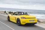 2018 Porsche 718 Boxster in Racing Yellow - Driving Rear Left Three-quarter View