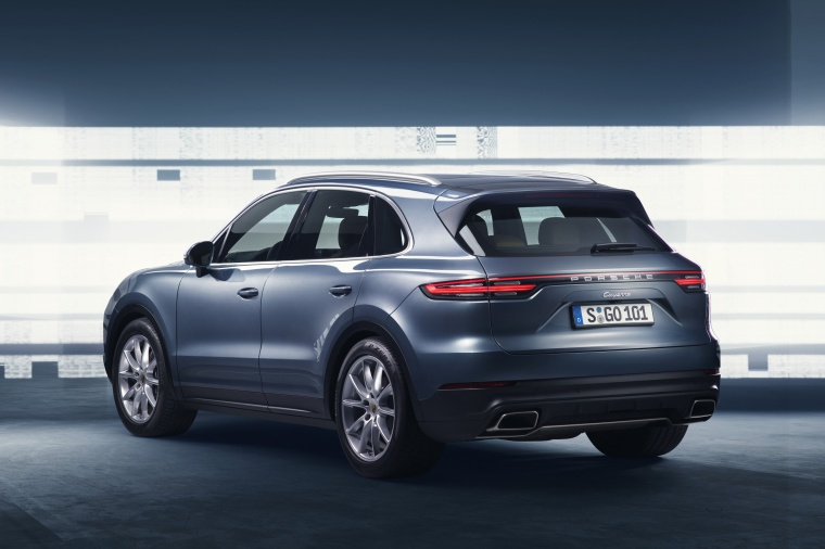 2019 Porsche Cayenne AWD in Biscay Blue Metallic from a rear left three-quarter view