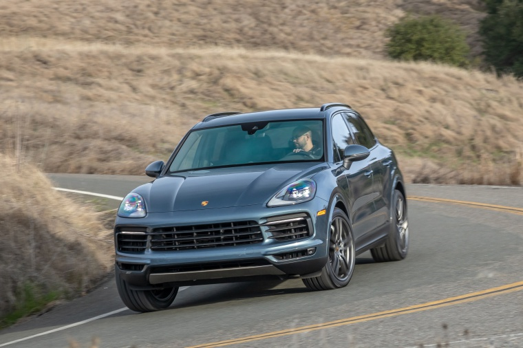Picture of a driving 2019 Porsche Cayenne AWD in Biscay Blue Metallic from a front left perspective