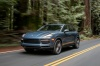 Picture of a driving 2019 Porsche Cayenne AWD in Biscay Blue Metallic from a front left three-quarter perspective