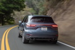 Picture of a driving 2019 Porsche Cayenne AWD in Biscay Blue Metallic from a rear left perspective