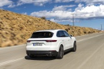 Picture of a driving 2019 Porsche Cayenne AWD in White from a rear right perspective
