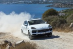 Picture of a driving 2019 Porsche Cayenne AWD in White from a front right perspective