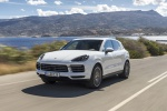 Picture of a driving 2019 Porsche Cayenne AWD in White from a front left perspective