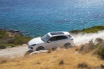 Picture of a driving 2019 Porsche Cayenne AWD in White from a front left three-quarter perspective