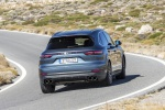 Picture of a driving 2019 Porsche Cayenne S AWD in Biscay Blue Metallic from a rear right perspective