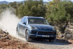 Picture of a driving 2019 Porsche Cayenne S AWD in Biscay Blue Metallic from a front right perspective