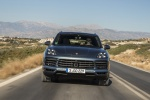 Picture of a driving 2019 Porsche Cayenne S AWD in Biscay Blue Metallic from a frontal perspective