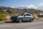 Picture of a driving 2019 Porsche Cayenne S AWD in Biscay Blue Metallic from a front left three-quarter perspective