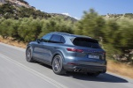 Picture of a driving 2019 Porsche Cayenne S AWD in Biscay Blue Metallic from a rear left three-quarter perspective