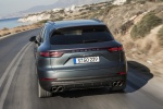 Picture of a driving 2019 Porsche Cayenne S AWD in Biscay Blue Metallic from a rear left perspective