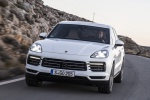 Picture of a driving 2019 Porsche Cayenne S AWD in White from a front left perspective