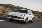 Picture of a driving 2019 Porsche Cayenne S AWD in White from a front left three-quarter perspective