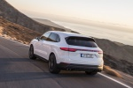 Picture of a driving 2019 Porsche Cayenne S AWD in White from a rear left three-quarter perspective
