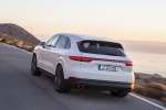 Picture of a driving 2019 Porsche Cayenne S AWD in White from a rear left perspective