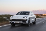 Picture of a driving 2019 Porsche Cayenne Turbo AWD in White from a front left perspective