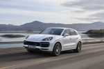 Picture of a driving 2019 Porsche Cayenne Turbo AWD in White from a front left three-quarter perspective