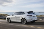 Picture of a driving 2019 Porsche Cayenne Turbo AWD in White from a rear left three-quarter perspective