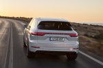 Picture of a driving 2019 Porsche Cayenne Turbo AWD in White from a rear perspective