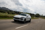 Picture of a driving 2019 Porsche Cayenne e-Hybrid AWD in White from a front left three-quarter perspective