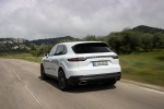 Picture of a driving 2019 Porsche Cayenne e-Hybrid AWD in White from a rear left perspective