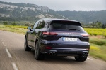 Picture of a driving 2019 Porsche Cayenne e-Hybrid AWD in Moonlight Blue Metallic from a rear perspective