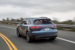 Picture of a driving 2019 Porsche Cayenne AWD in Biscay Blue Metallic from a rear left three-quarter perspective