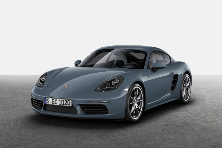 2018 Porsche 718 Cayman in Graphite Blue Metallic from a front left three-quarter view