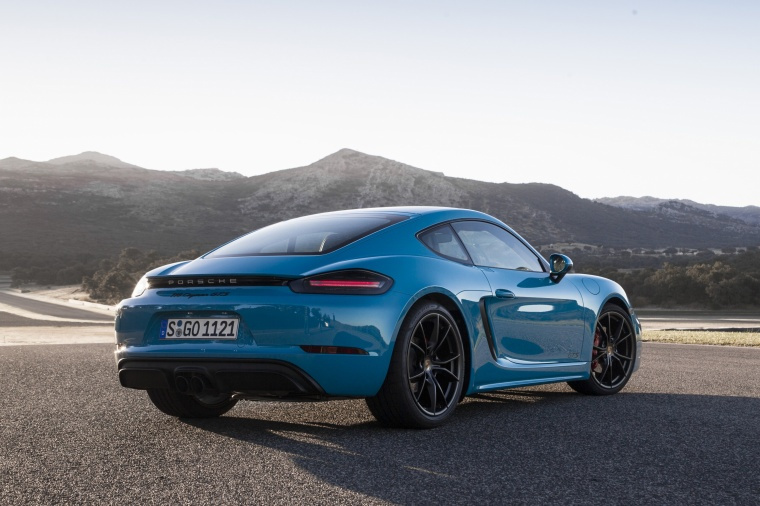 2018 Porsche 718 Cayman GTS in Miami Blue from a rear right three-quarter view