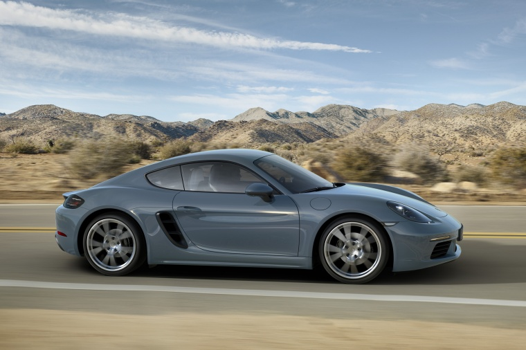 Driving 2018 Porsche 718 Cayman in Graphite Blue Metallic from a right side view