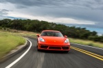 2018 Porsche 718 Cayman S in Lava Orange - Driving Frontal View