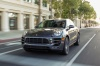 Driving 2016 Porsche Macan Turbo in Agate Gray Metallic from a frontal view