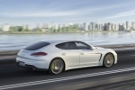 2014 Porsche Panamera S e-Hybrid in White - Driving Rear Right Three-quarter View