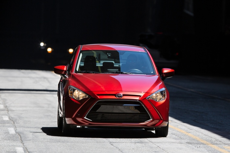 Driving 2016 Scion iA Sedan in Pulse from a frontal view